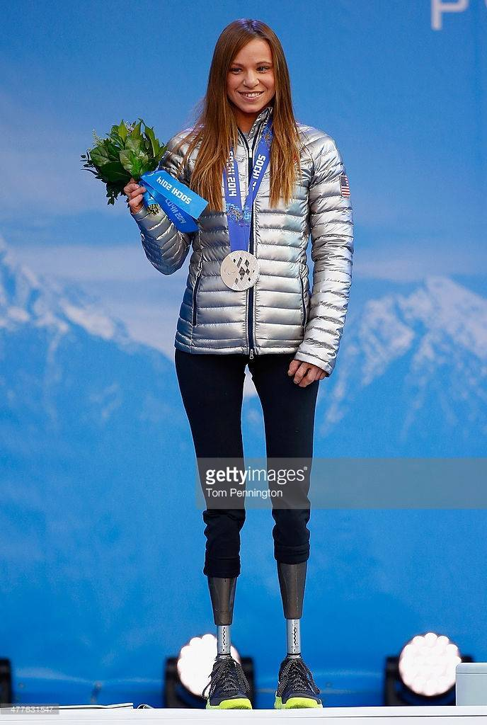 A photo of Oksana on the medal platform with her silver medal for the Nordic Biathalon in the 2014 Paralympic Winter Games.