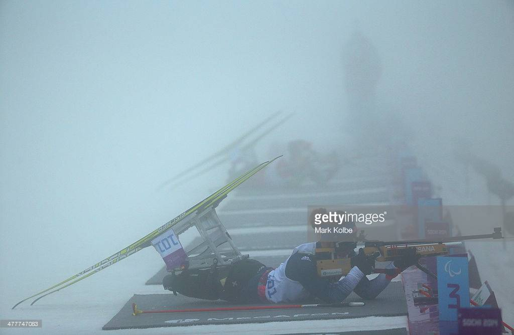 A photo from Getty Images of Oksana firing her rifle during the Nordic Biathalon at the 2014 Paralympic Winter Games.