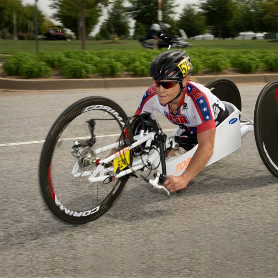 A photo of Oksana competing in Paracycling Hand Cycling Road Races in the UCI Paracycling Road World Championships.