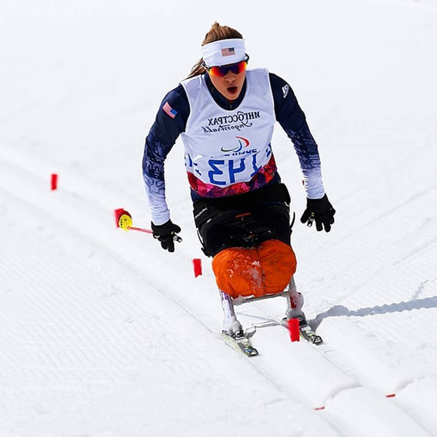 A close up photo of Oksana competing in Nordic Skiing at the 2014 Paralympic Winter Games.
